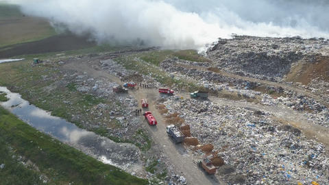 Garbage dump pollutes the environment. Strong wind rises toxic smoke of burning Footage