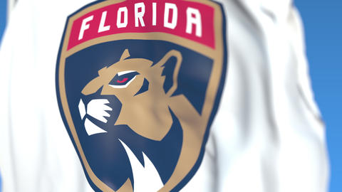Waving flag with Florida Panthers NHL hockey team logo, close-up. Editorial Live Action