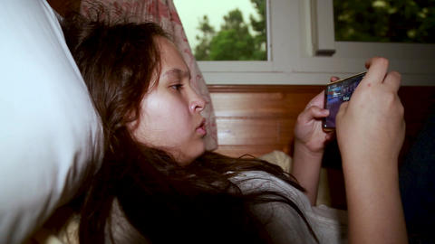 Tween playing with smartphone 28 Footage