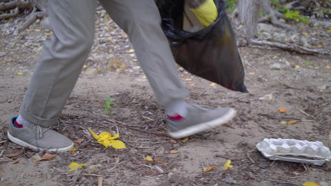 volunteers with garbage bags cleaning forest Live Action