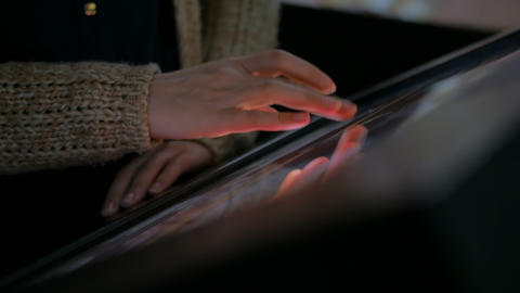 Woman using interactive touchscreen display Live Action