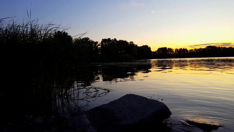Sunrise or Sunset View of Calm Pond and Lake Water in Summer. Tranquil Idyllic Nature Landscape at Live Action
