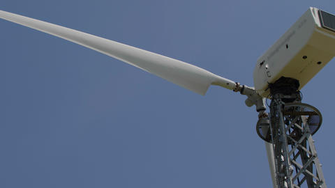 Wind turbine blades Slow rotation on blue sky background Live Action
