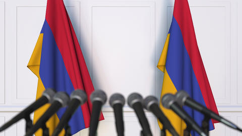 Armenian official press conference. Flags of Armenia and microphones. Conceptual Live Action