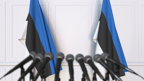 Estonian official press conference. Flags of Estonia and microphones. Conceptual Live Action