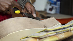 Craftsman using chisel in guitar that is being made Footage