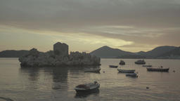 Sea at sunset. Seascape with boats on water in sunset light. The Balkans Footage