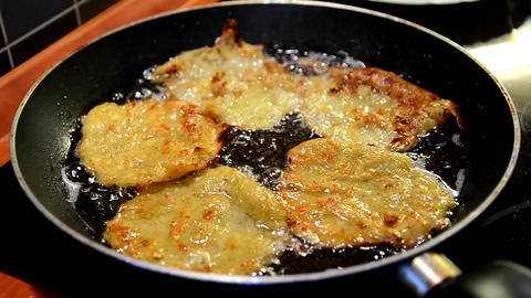 Zucchini pancake frying Footage