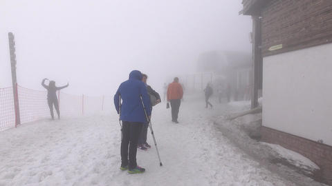 Injured person rise up hands and crutches, alpine resort area, foggy air Footage
