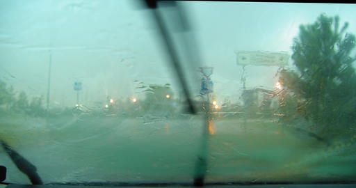 Heavy rain from inside car with windscreen wiper going Live Action