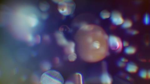 Light glare lights defocused in motion on black background HD Footage