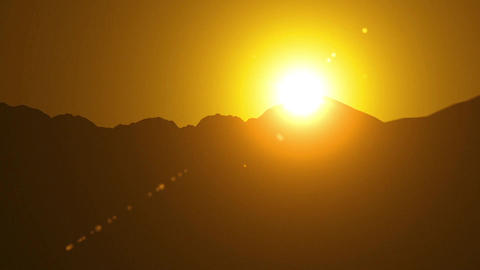 Sunset in the evening over the mountains view in motion HD Footage