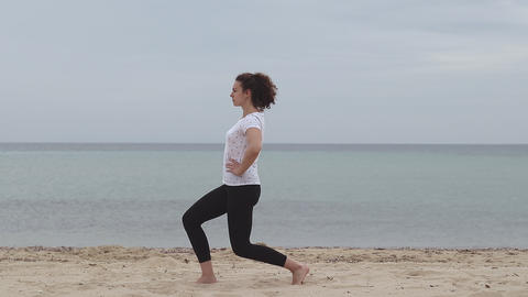 Fitness, sport and healthy lifestyle concept. Young woman doing recreation on the beach. Young woman Live Action