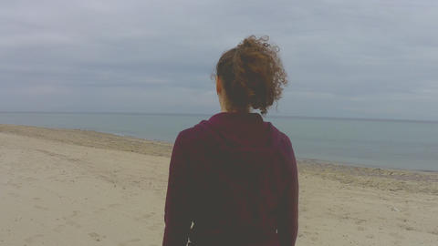 Close up of beautiful young woman walking by the sea on a…, Live Action