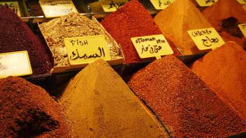 Many piles of spices in turkish traditional souk market Live Action