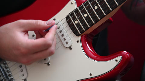 Close up man playing red electric guitar Footage