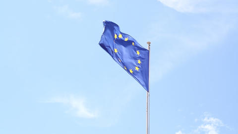 Close up flag of EU waving in wind over blue sky Live Action