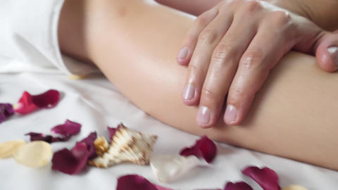 Male Masseur Hand Massages Leg in Spa Salon Footage
