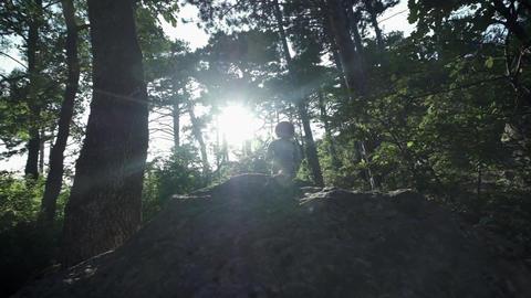 SLOW MOTION, CLOSE UP: Unrecognizable courageous male hiker climbing mountaintop Footage