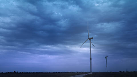 Wind turbines produce environmental energy. The concept of environmental Live Action