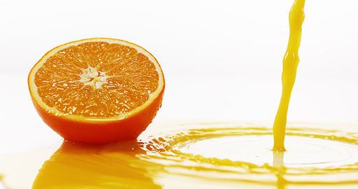 Orange, citrus sinensis, Orange Juice Flowing against White background, Slow Motion 4K Live Action