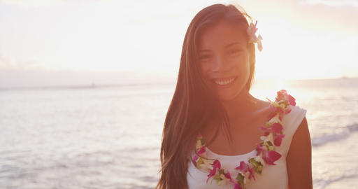 Hawaii woman wearing lei flower necklace on beach sunset for luau party Hawaii Footage