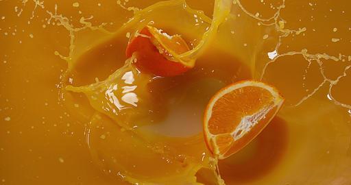 Orange, citrus sinensis, Fruit falling into Orange Juice, Slow Motion 4K Live Action