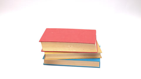 Colorful book rising on white background - Stop motion Animation