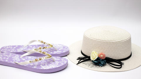 White woman's hat with sunglasses and sea shells on white background - Stop motion Animation