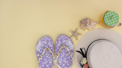 Summer kit and woman's accessories for the beach on the yellow background - Stop motion Animation
