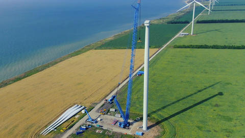 Aerial footage of the wind farm and the construction site of a wind turbine Live Action