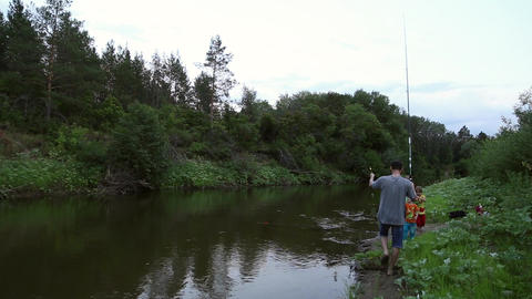 Family fishing on the river Footage