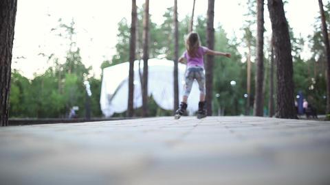Girl goes on roller skates Footage