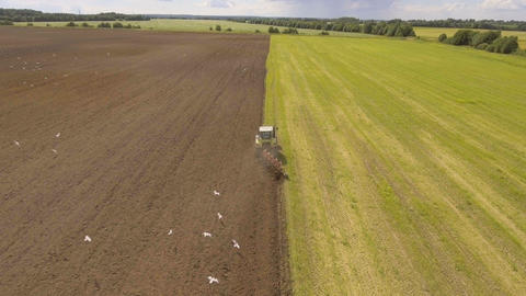 Tractor plowing a field.Aerial video Footage