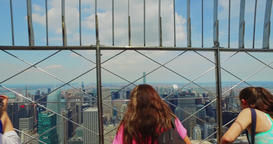 Tourists at the Top of the Empire State Building Enjoy the View of Manhattan Footage