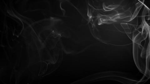 Smoke fumes against a black background Footage