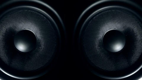 Set of round audio speakers vibrating from sound Live Action