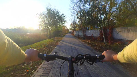A person cycling on a bicycle ride fast Footage