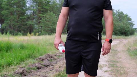 adult full athlete in a black uniform goes after a run Acción en vivo