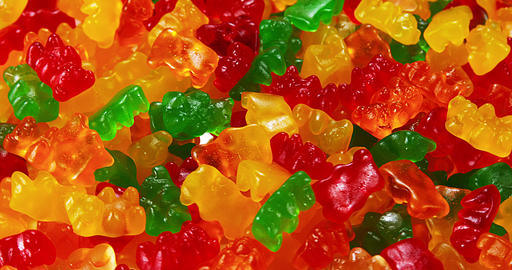 Gold Bears or Gummy Bears turning, Slow Motion Live Action