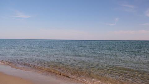 sea view from the sandy shore on a summer day Acción en vivo