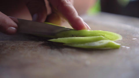 Green pepper get slicing by old lady. Prepare for cooking. Vegetarian Footage