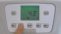 Setting higher temperature of the tap water on the gas boiler lcd display Filmmaterial