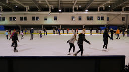 People ice skating. Ice skating rink Live Action