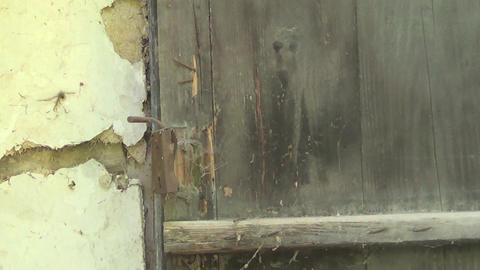 Old and abandoned house front door with handle GIF