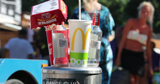 Fast Food And Drinks Packaging On A Stainless Steel Bollard Live Action