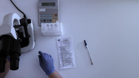 Top view of laboratory desktop of a medical clinic researcher Filmmaterial