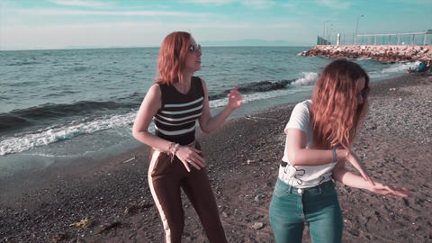 Girls are dancing on beach. Happy summer party, fun at beach. Friendship celebration Footage