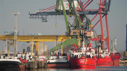 Shipyard cranes and ships in Gdansk shipyard, Poland Footage