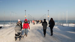 Gdansk, Poland. Baltic sea and strolling people. Pier in winter scenery Live Action